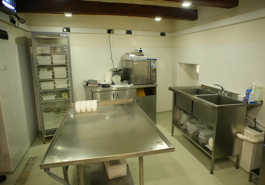 Photo of the room were cheeselets are produced, were everything is of stainless steel and very clean